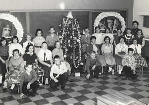 Christmas, Hoover School  6th Grade.jpg1st row on Left side 2 boy William Connerty 2nd row sitting  2nd girl Karen Ross 3rd row standing 1st girl Sue England, 4th girl in Susan Willer and Drew Stohl   Other side of the tree right side 2nd boy kneeling Bob Gallione Teacher Ms Rayburn