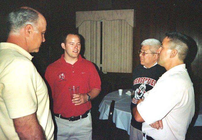 Kurt Bacci'75, Coach Kevin Manning'95, Kevin Wada'73
